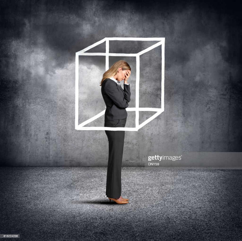 Woman feeling boxed in stock photo getty images woman feeling boxed in stock photo buycottarizona Gallery