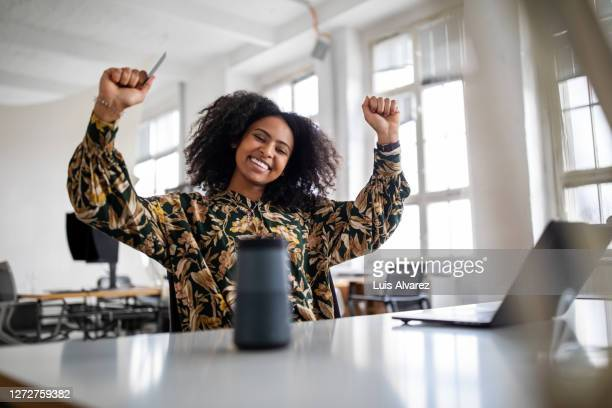 woman feeling excited with online shopping experience - customer stock pictures, royalty-free photos & images