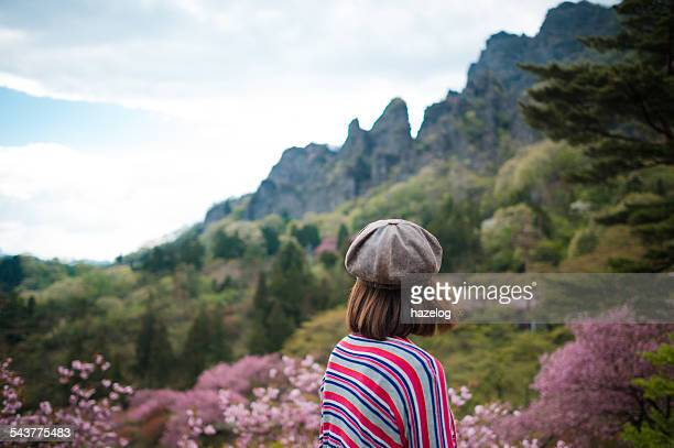 woman feeling the beautiful spring breeze - four seasons stock pictures, royalty-free photos & images