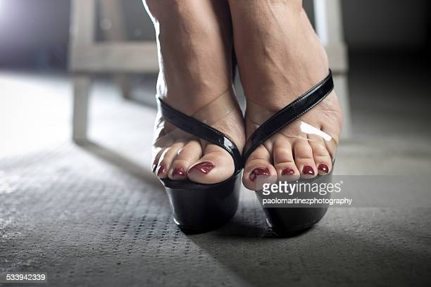 woman feet with red nail polish on high heels - pretty toes and feet stock photos and pictures