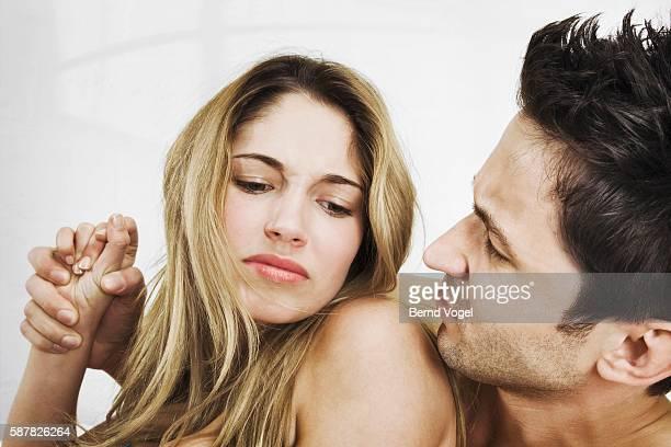 Woman fending off a man