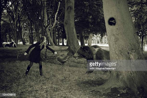 Woman fighting with a bear in a forest, Republic of Ireland