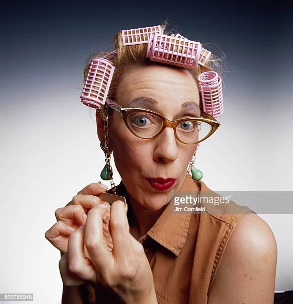 Woman Filing Her Fingernails