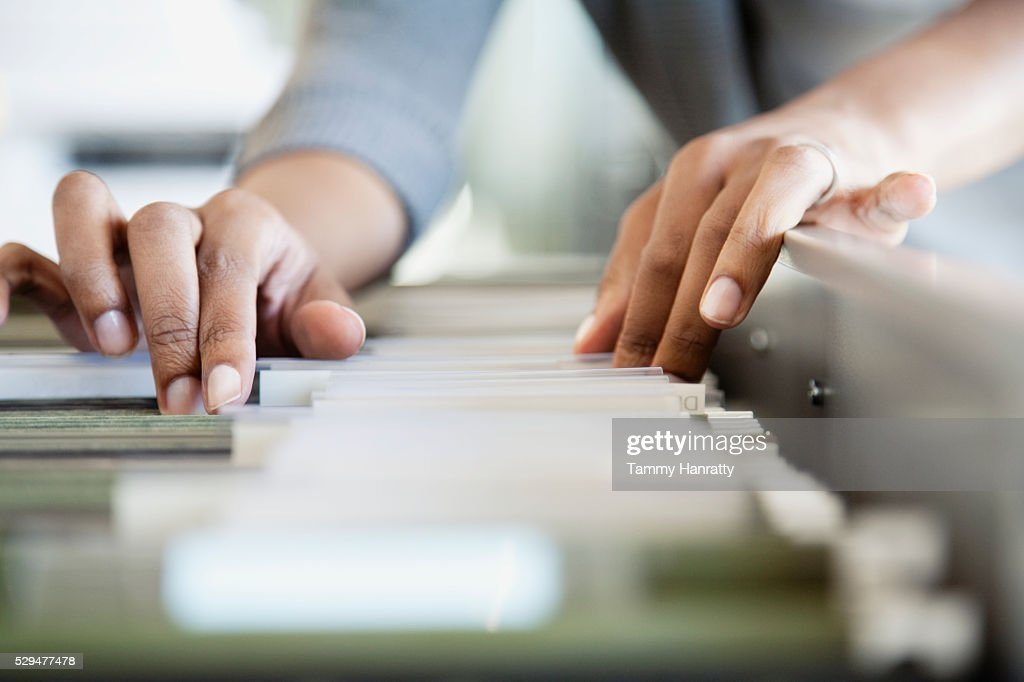Woman filing in office : Stockfoto