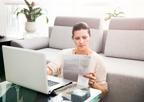 Woman Filing Income Tax Online 1091896434