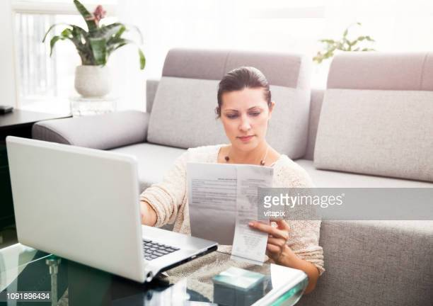 woman filing income tax online - form filling stock pictures, royalty-free photos & images