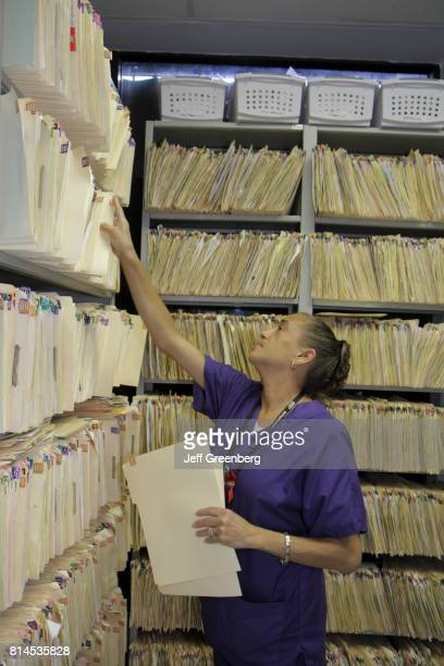 A woman filing patient records at the Borinquen Health Care Center