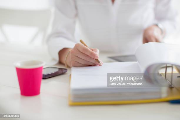 Woman filling documents