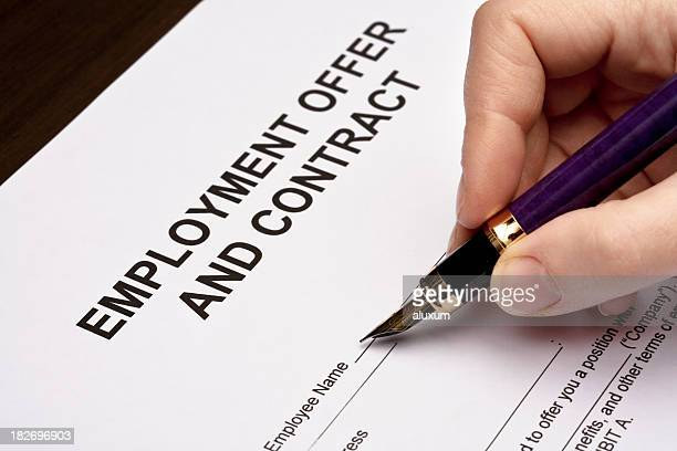 Woman filling out employment offer document