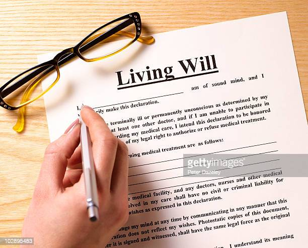 Woman filling out living will