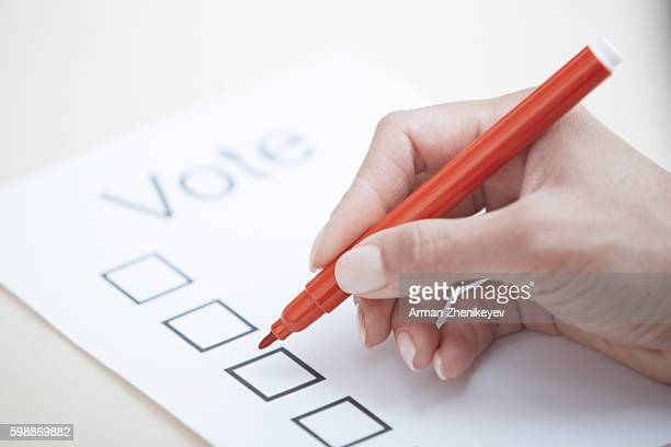 Woman filling out voting document