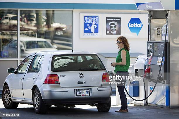 A woman fills a car with fuel at a Chevron Corp gas station in Vancouver British Columbia Canada on Friday May 6 2016 The worst wildfire in Alberta...