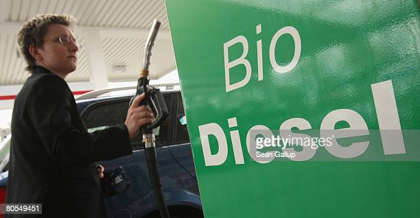 A woman fills her car's tank with gasoline at a gas station that also sells biofuels on April 7 2008 in Berlin Germany The German government recently...