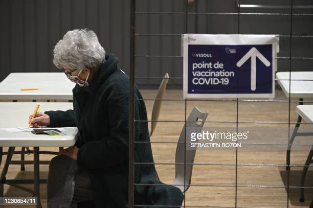 Woman fills in a medical questionnaire at a vaccination centre in Vesoul, eastern France, before receiving an injection of a Covid-19 vaccine on...