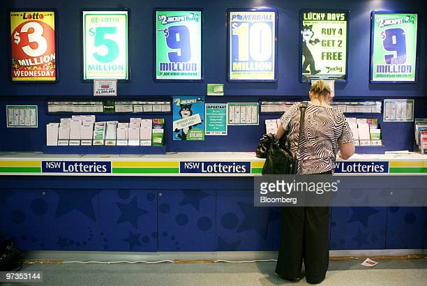 A woman fills out a lottery ticket card at a New South Wales Lotteries Corp retail outlet in Sydney Australia on Tuesday March 2 2010 Tatts Group Ltd...