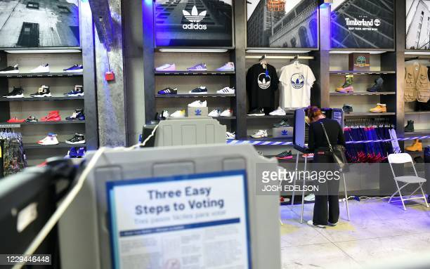 A woman fills out her ballot at a Shiekh shoe store on election day in San Francisco California on November 3 2020 The US started voting Tuesday in...