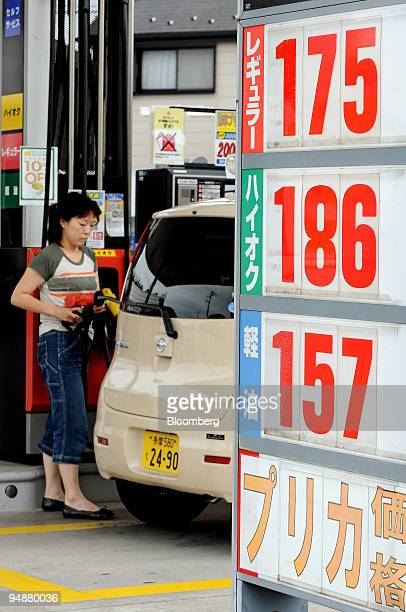 A woman fills up her car at a gas station in Tokyo Japan on Wednesday July 9 2008 Japan's consumer prices probably rose at the fastest pace in a...