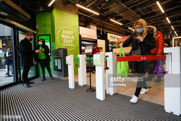 Woman films herself as she exits the Amazon.com Inc. Amazon Fresh cashierless convenience store in the Ealing area of London, U.K., on Thursday,...