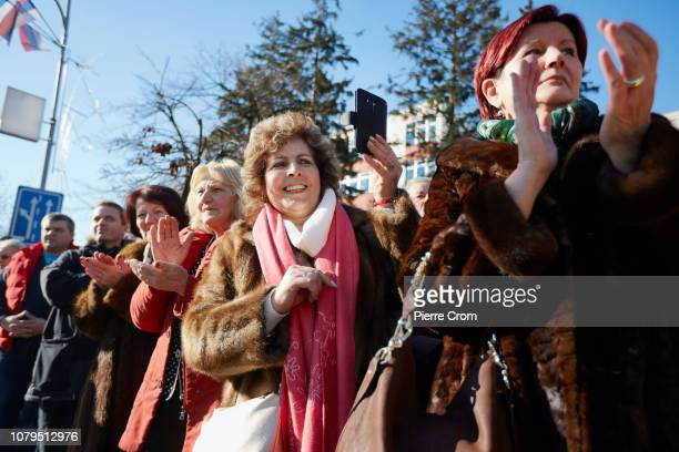 A woman films the parade in Banja Luka with her smartphone on January 9 2019 in Banja Luka Bosnia and Herzegovina Republika Srpska the Serbian entity...