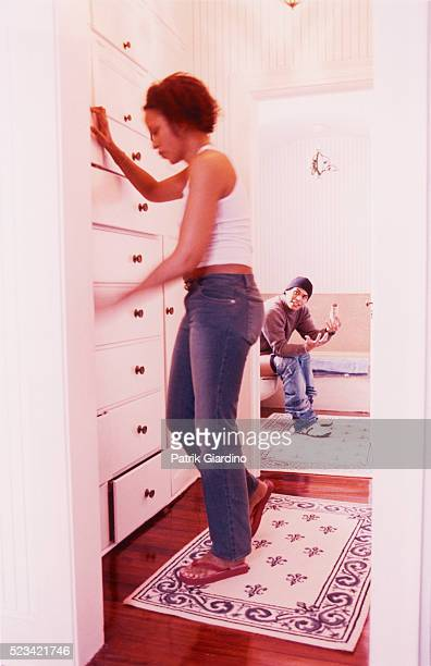 woman finding toilet paper for man - men taking a dump stock photos and pictures