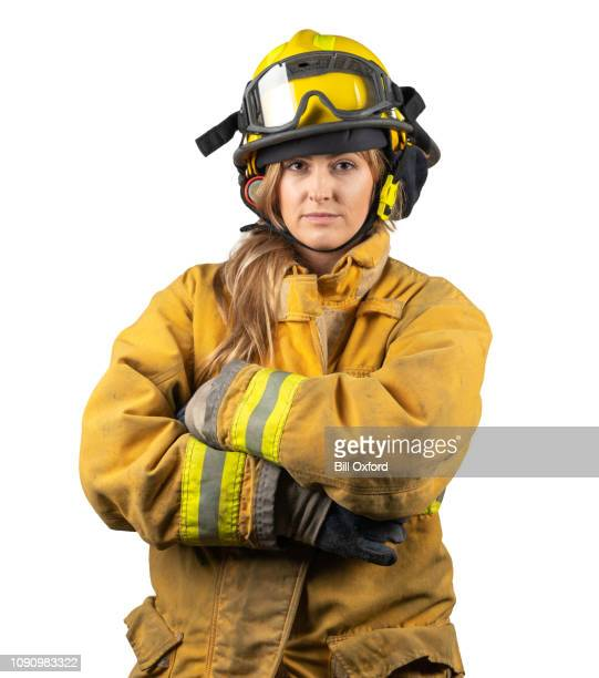 woman firefighter: fireman on white background looking confident at camera - firefighter stock pictures, royalty-free photos & images