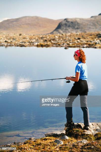 Woman fishing in river