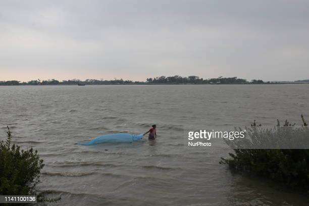 A woman fishing in the Shibsha river at Dakop after Cyclone Fani hits in Khulna Bangladesh on May 4 2019