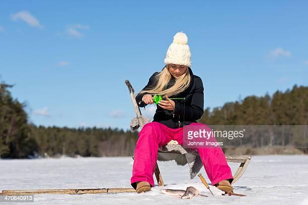 Woman fishing in the winter