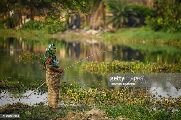 A woman fishs on the Mayur River on April 11 2016 in Khulna Bangladesh