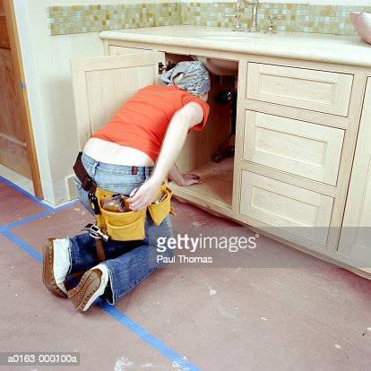 Woman Fixing Bathroom Sink High Res Stock Photo Getty Images