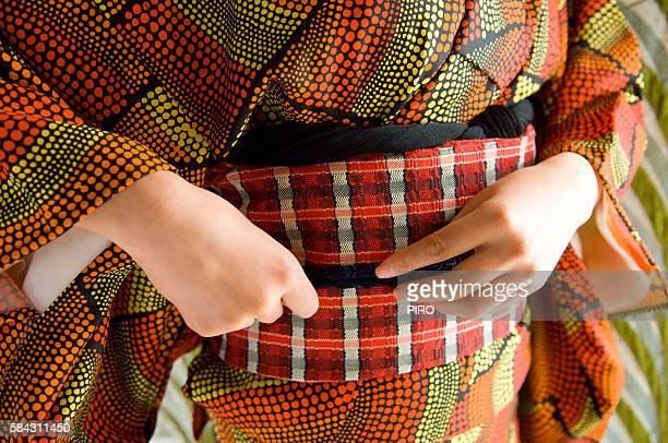 A woman fixing up kimono