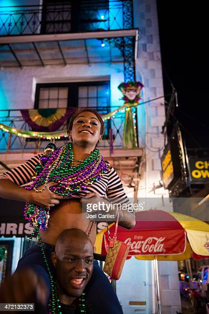 Woman flashing breasts for beads during Mardi Gras