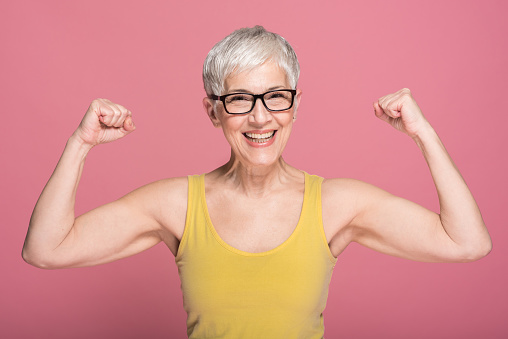 Woman flexing muscles 1152372180