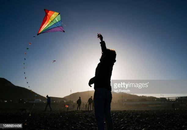 A woman flies a kite on the beach on New Year's Day morning on January 01 2019 in Saltburn By The Sea England