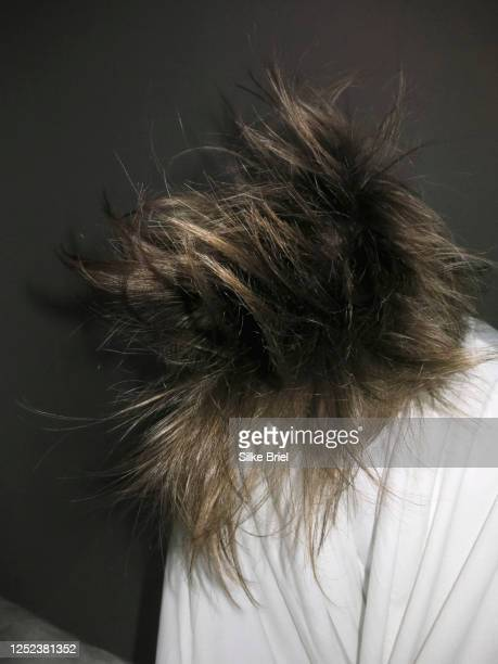 woman flipping hair - briel stock pictures, royalty-free photos & images
