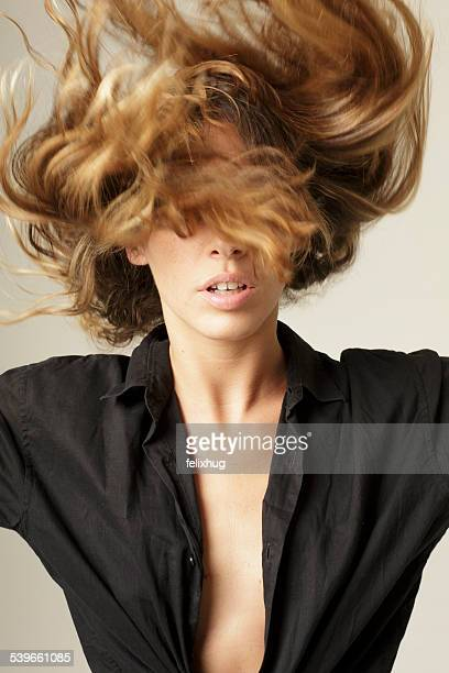 woman flipping long blond hair - open blouse stock photos and pictures