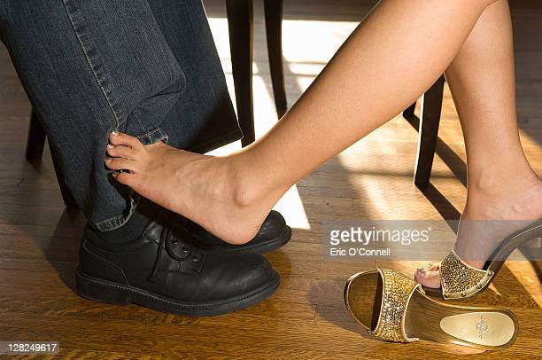 Woman flirting with her foot under a table