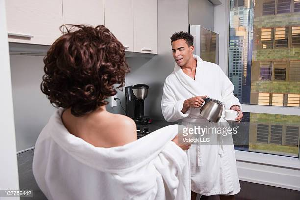 Woman flirting with man in hotel room