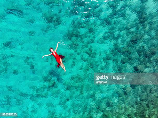 Woman Floating and Swimming on a Tropical Sea