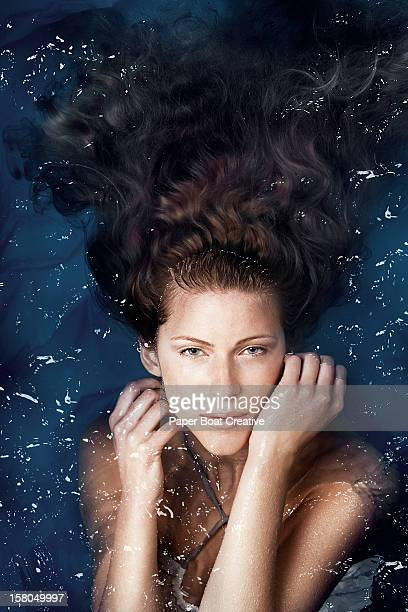 woman floating in a swimming pool - spa treatment stock pictures, royalty-free photos & images
