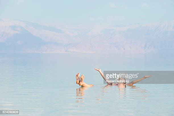 woman floating in dead sea. - israeli woman stock pictures, royalty-free photos & images