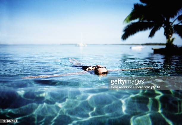 Woman floating in peaceful water