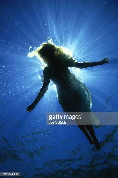Woman floating in sea, underwater view