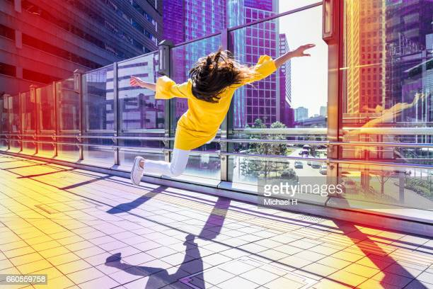 woman floating in the city - frau bluse durchsichtig stock-fotos und bilder