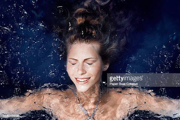Woman floating in the pool of a spa