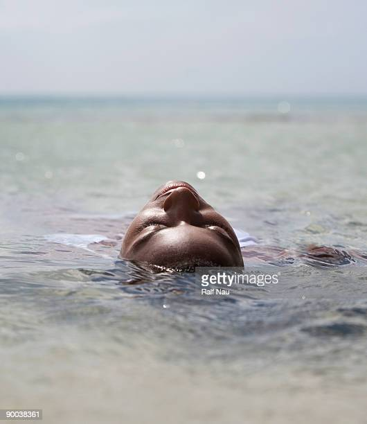 Woman floating in water