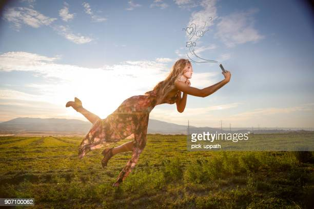 Woman floating mid air with phone