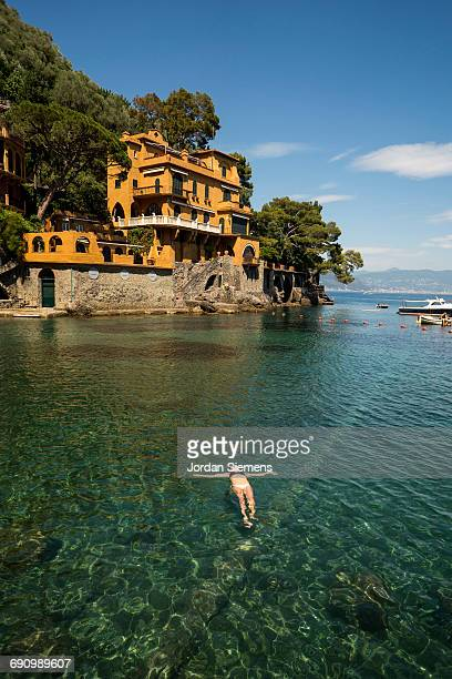 a woman floating on her back - portofino stock pictures, royalty-free photos & images