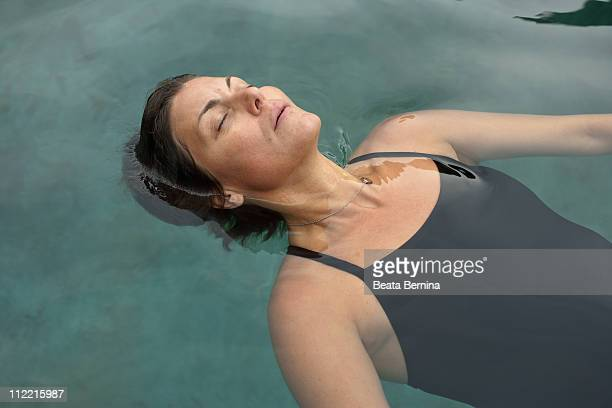woman floating - scandinavian ethnicity stock pictures, royalty-free photos & images