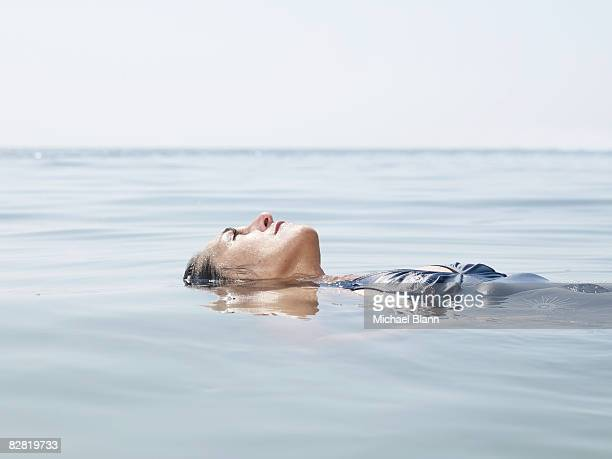 Woman floats in the water
